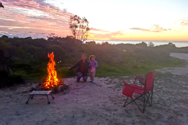 Em and I toasting marshmallows in the fire on the end of a stick