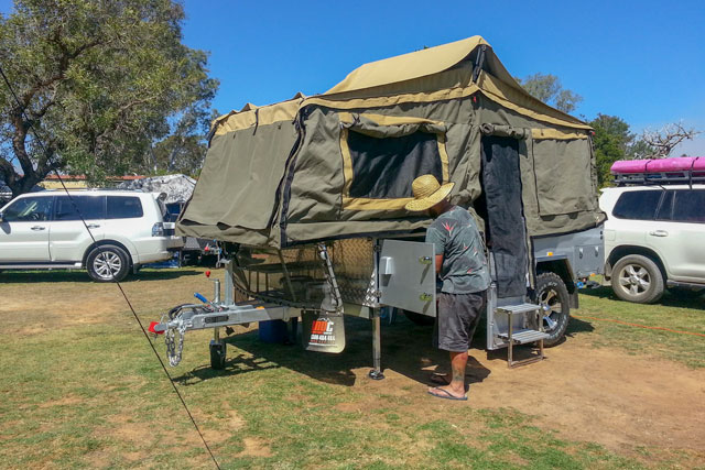Rick working out how to set up our new camper trailer
