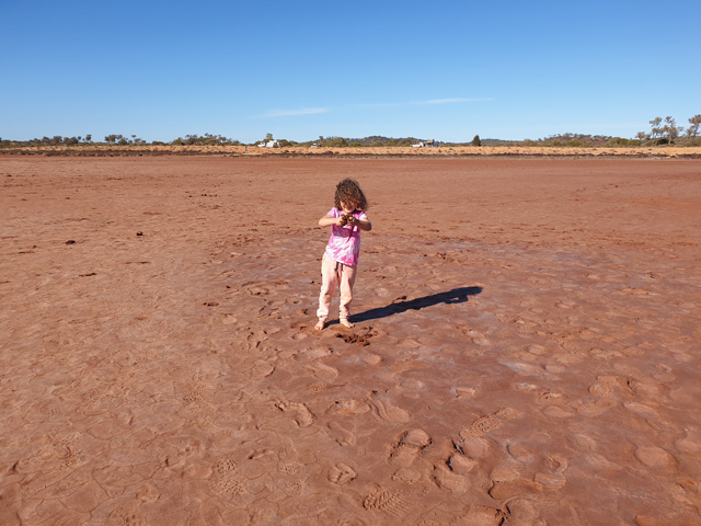 Lala playing with clay at Lake Ballard